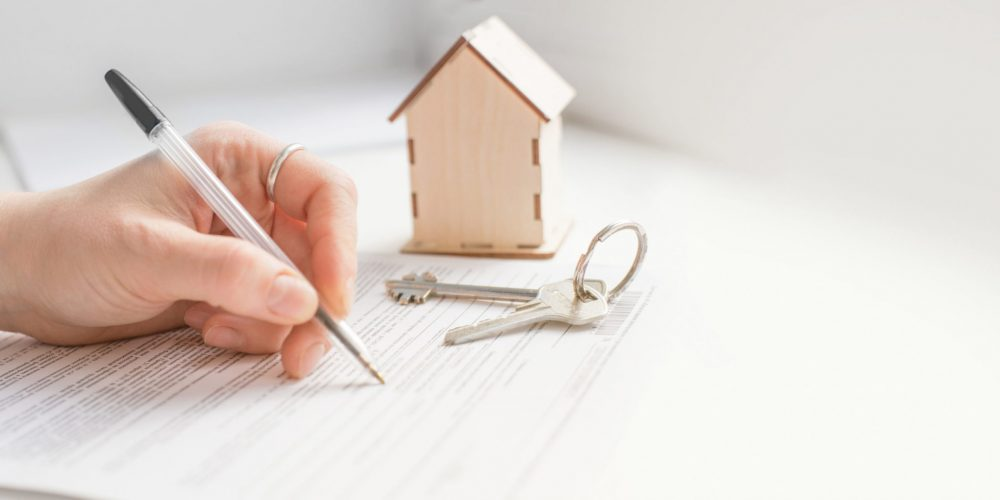 mortgage and housing rent. Keys, house and hand that signs documents. free space for text